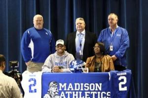 (Seated l-r) Dre Twyman and mother Teneshia West. (Standing l-r) Coach Stuart Dean, MCHS Principal gary Wintersgill, Athletic Director Phil Warren