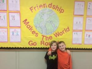 Hunter Pack and Carson Jenkins in Front of Bulletin Board